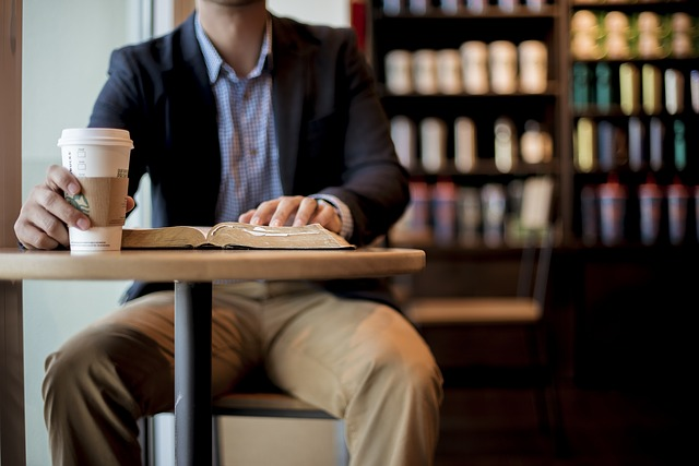man reading with starbucks coffee